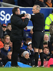 Referee Martin Atkinson (right) has his equipment changed during the Premier League match at Goodison Park, Liverpool.