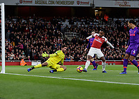 Football - 2018 / 2019 Premier League - Arsenal vs. Liverpool<br /> <br /> Alexandre Lacazette (Arsenal FC) forces an early save from Alisson Becker (Liverpool FC) at The Emirates.<br /> <br /> COLORSPORT/DANIEL BEARHAM