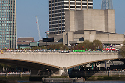 London, UK. 20th April 2019. Waterloo bridge, seen from the Embankment, has been blocked by climate change campaigners from Extinction Rebellion for six days. During that time, they have created a Garden bridge used for International Rebellion activities to demand urgent action to combat climate change by the British government.