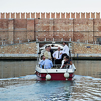 "VENICE, ITALY - OCTOBER 01:  Paolo Baratta president of The Biennale (C) is seen on a motor boat during the ""Vogata Rituale - Cultura in Memoriam"" heading towards San Michele Cemetery on October 1, 2011 in Venice, Italy.  Vogata Rituale - Cultura in Memoriam is part of the 55. Festival Internazionale di Musica Contemporanea organised by the Biannale."