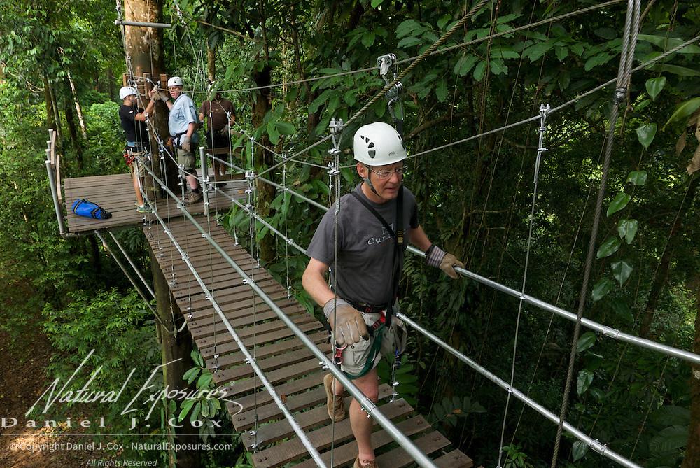 Tom on suspension bridge during zip line run. Costa Rica.
