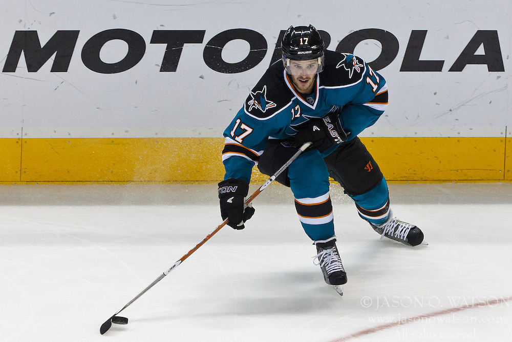 Mar 24, 2012; San Jose, CA, USA; San Jose Sharks left wing Torrey Mitchell (17) skates with the puck against the Phoenix Coyotes during the third period at HP Pavilion.  San Jose defeated Phoenix 4-3 in shootouts. Mandatory Credit: Jason O. Watson-US PRESSWIRE