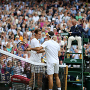 LONDON, ENGLAND - JULY 14: Winner Roger Federer of Switzerland is congratulated by Thomas Berdych of the Czech Republic after the Gentlemen's Singles Semi-final of the Wimbledon Lawn Tennis Championships at the All England Lawn Tennis and Croquet Club at Wimbledon on July 14, 2017 in London, England. (Photo by Tim Clayton/Corbis via Getty Images)