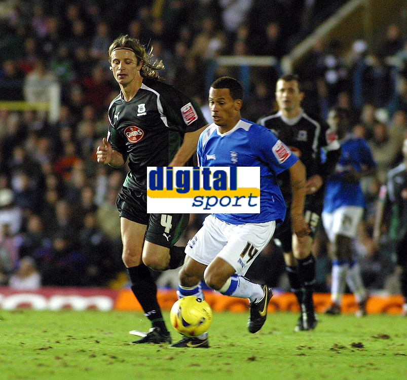 Photo: Dave Linney.<br />Birmingham City v Plymouth Argyle. Coca Cola Championship. 02/12/2006. Bham City's  DJ Campbell heads down the wing past the Plymouth defence.