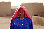 Mother with ancient pharonic nose ring in the tiny oasis of Ain El Taneen, near Farafra Egypt