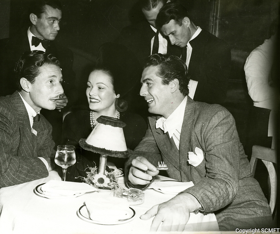 1949 Olga Cassini, Gene Tierney & Victor Mature at the Mocambo Nightclub in West Hollywood