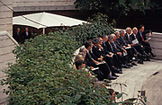 Businessmen sit in urban City sunshine during their lunch hour spent in Broadgate Circle, an Eighties development of offices and trading institutions, on 16th June 1994, in London, England.