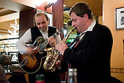 Jazz musicians play music at Brasserie Bowfinger on New Year's Eve, Paris, France
