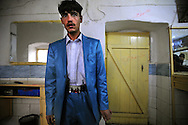 Obama family in the belt of a Kabul Young Guy, Afghanistan. 2010.