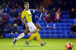 Peterborough United's Britt Assombalonga in action with Exter City's Scott Bennett - Photo mandatory by-line: Joe Dent/JMP - Tel: Mobile: 07966 386802 09/11/2013 - SPORT - FOOTBALL - London Road Stadium - Peterborough - Peterborough United v Exeter City - FA Cup - First Round