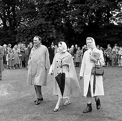 HM The Queen Elizabeth II with the 3rd Viscount Cowdray and Viscountess Cowdray at the Cowdray Gold Cup Polo, Cowdray Park, Midhurst, Sussex on 10th July 1960.