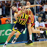 Galatasaray's Luksa ANDRIC (B) and Fenerbahce Ulker's Omer ONAN (F) during their Turkish Basketball league Play Off Final third leg match Galatasaray between Fenerbahce Ulker at the Abdi Ipekci Arena in Istanbul Turkey on Thursday 09 June 2011. Photo by TURKPIX