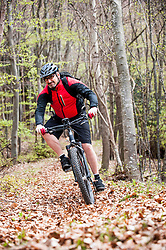 Man racing autumn forest electric mountainbike