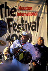 Stock photo of a man playing an accordion on stage at the International Festival in downtown Houston Texas