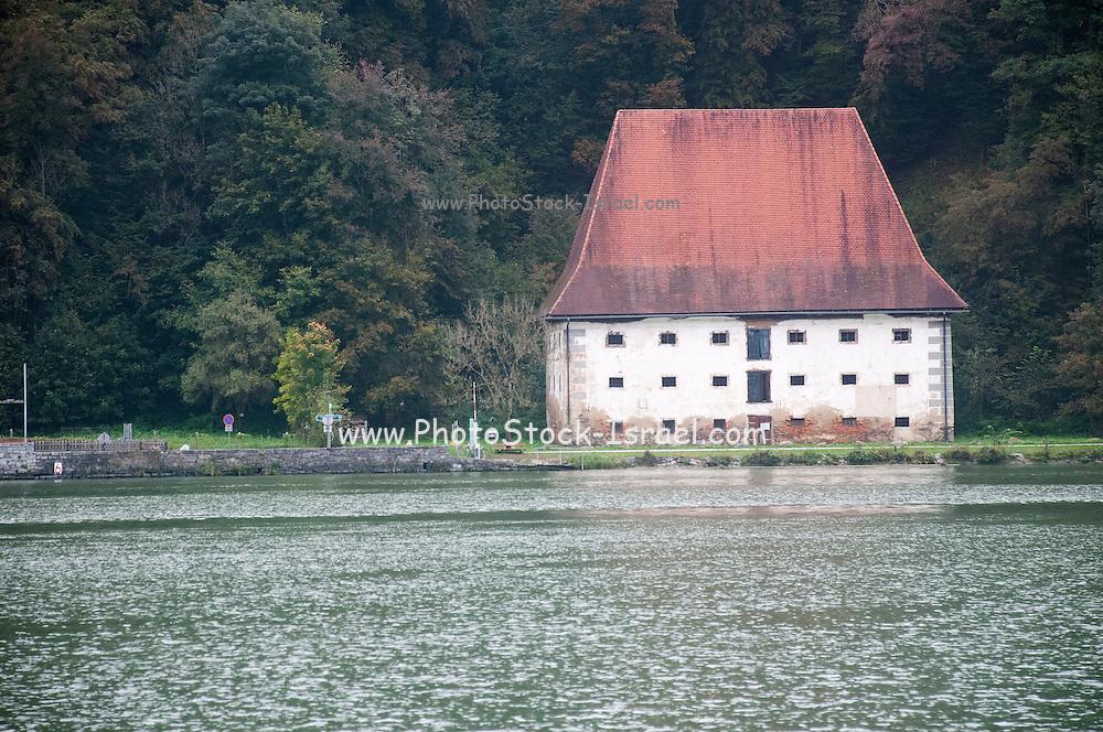 Reconstructed Historic Grain Silo in Grafenau, Austria. The Danube river in the foreground