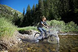 Scott Hunter Mountain Biking across Rainey Creek in Swan Valley, Idaho