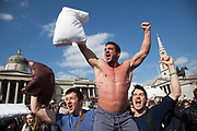 London, UK. Saturday 6th April 2013. World Pillow Fight Day. People having fun in London's mass feathery fracas taking place in Trafalgar Square. This flashmob event is organised by the Urban Playground Movement. A pillow fight flash mob is a social phenomenon of flash mobbing and shares many characteristics of a culture jam.