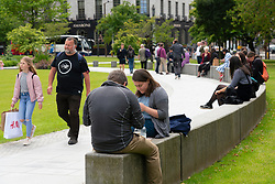 Edinburgh, Scotland, UK. 2 July, 2020. Good weather brought many people outdoors and into public parks and gardens which are now open. Here in St Andrew Square  garden people were relaxing and mostly exercising social distancing. Iain Masterton/Alamy Live News