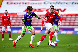 Jamie Paterson of Bristol City takes on Cauley Woodrow of Barnsley - Mandatory by-line: Robbie Stephenson/JMP - 17/10/2020 - FOOTBALL - Oakwell Stadium - Barnsley, England - Barnsley v Bristol City - Sky Bet Championship