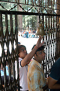 India, Vashisht near Manali, Kullu District, Himachal Pradesh, Northern India, sage Vashisht temple, also famous, for its hot sulphur springs The entrance gate and bell, locals entering the compound