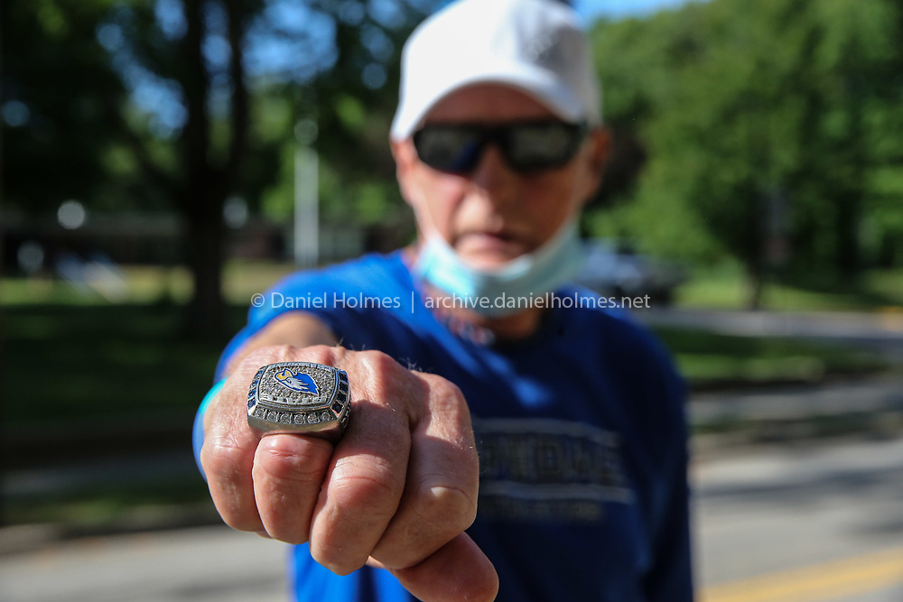 Hopedale running coach, Joe Drugan, 76, shows a Hopedale Cross-Country championship ring before he runs the Crush Corona 5K starting at Hopedale Memorial Elementary School on Jun. 12, 2020. The 5K was setup to honor and celebrate those people over 70 who have suffered or lost their lives during the coronavirus pandemic. [Daily News and Wicked Local Photo/Dan Holmes]