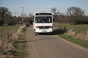 Far East Travel minibus on rural route, Boyton, Suffolk, England