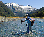 Hikers must cross Siberia Stream to reach Siberia Hut from the airstrip in Siberia Valley, Mount Aspiring National Park, Southern Alps, South Island, New Zealand. In 1990, UNESCO honored Te Wahipounamu - South West New Zealand as a World Heritage Area. For licensing options, please inquire.