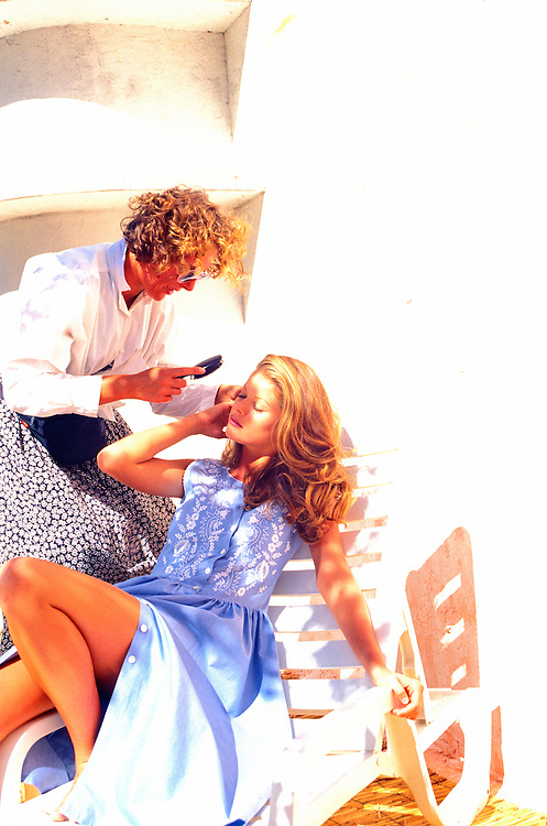 A young fashion model is readied by a hair stylist for a photo-shoot atop an Art Deco hotel in Miami's Beach's historic South Beach district