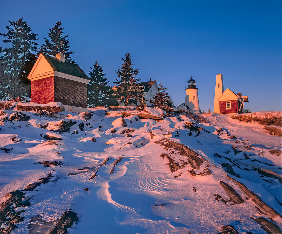 Bell tower & Pemaquid Point Lighthouse, snow on bedrock, spruce trees, winter, Pemaquid, ME