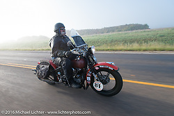 Carl Olsen riding his 1936 Harley-Davidson Knucklehead in the fog at the beginning of Stage 8 of the Motorcycle Cannonball Cross-Country Endurance Run, which on this day ran from Junction City, KS to Burlington, CO., USA. Saturday, September 13, 2014.  Photography ©2014 Michael Lichter.
