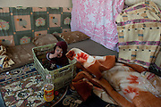 El Qaa, Lebanon, 30 meters from the border with Syria. This boy is part of a family of Syrian refugees who came from Nizarié. They have been living with 11 persons in a 1 room house without water or electricity for 3 months.