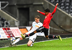 Joe Lewis of Swansea City under pressure from DJ Buffonge of Manchester United' - Mandatory by-line: Craig Thomas/Replay images - 18/03/2018 - FOOTBALL - Liberty Stadium - Swansea, England - Swansea City U23 v Manchester United U23 - Premier League 2 - Divison 1
