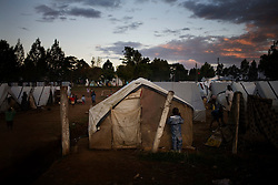 Dusk falls at an IDP camp in Eldoret, Kenya. Four months after election violence erupted in Kenya there are still some 300,000 people displaced, half of which are living in IDP camps. The violence was centered in the Rift Valley, Kenya's fertile bread basket.  Due to the violence and displacement many Kenya farmers have been unable to work their land for 4 months, leading to worries that Kenya will face severe food shortages by the end of the year.