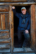 Staffan Widstrand, photographer and Managing Director of Wild Wonders of China, standing infront of a hiker's cabin at small camp, near the glacier lake at  Mount Bawu Bameng, in the Meili Snow Mountain National park, Yunnan China.