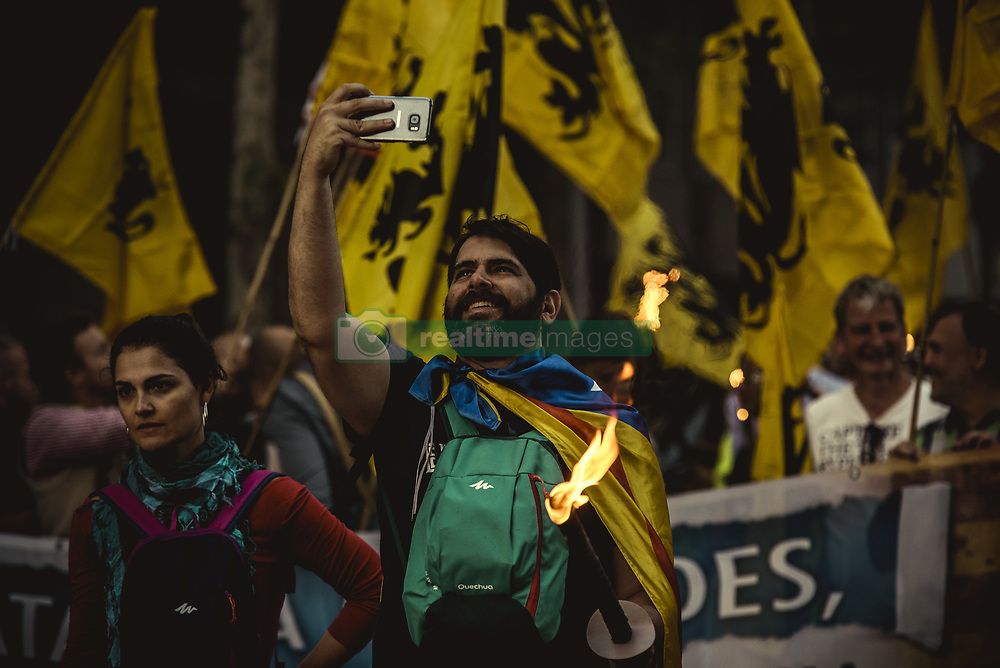 September 10, 2017 - A Catalan nationalist takes a 'selfie' as he participates in a pro-independence torch procession on Catalonia's National Day eve (Credit Image: © Matthias Oesterle via ZUMA Wire)