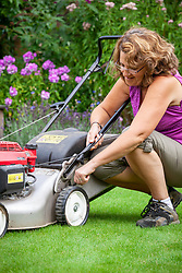 Raising the cutting height of the blades on a lawn mower