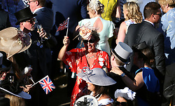 Racegoers around the bandstand waving union jack flags during day three of Royal Ascot at Ascot Racecourse.
