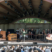 """Conductor Joshua Gersen, Colin Fowler and red fish blue fish perform Lou Harrison's """"Concerto for Organ with Percussion Orchestra"""" at Libbey Bowl on June 9, 2013 in Ojai, California."""