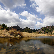 LOS ANGELES, CA, October 2, 2007: Clouds reflect in the water on a fall day in September in the Santa Monica Mountains. . (Photo by Todd Bigelow/Aurora)