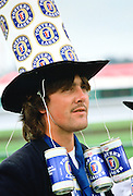 Racegoer  wearing a ' Fosters Lager' hat to  the Melbourne Cup Race Day, Australia