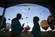 AARP's Bruce Breslau talks with coworker Daniela Romero at the AARP Block Party at the Albuquerque International Balloon Fiesta in Albuquerque New Mexico USA on Oct. 8th, 2018.