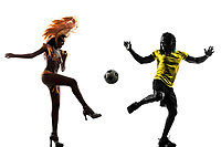 two Brazilian soccer football player man and Samba dancer woman in silhouette studio on white background