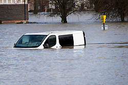 © Licensed to London News Pictures. 25/02/2020. Shrewsbury, Shropshire, UK. A van is half  submerged at the Guildhall Riverside carpark as the River Severn levels continue to rise at Shrewsbury in Shropshire, UK causing severe flood disaster situation. The Environment Agency forecast levels to peak soon. The level at 12.45 hrs at Welsh Bridge was 5.07 metres. Photo credit: Graham M. Lawrence/LNP