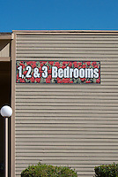 Real estate sign on the side of a housing estate in Las Vegas advertising 1, 2 and 3 bedroom units