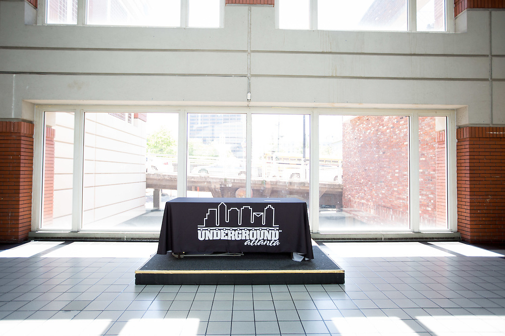 An empty table in the food court at Underground Atlanta on Friday, April 24, 2015 in Atlanta. A South Carolina development company, WRS, Inc., is under contract to purchase Underground from the city of Atlanta, with the deal expected to close in September. The company's plan calls for 800 or 900 apartments, a grocery store and other retailers to fill spaces currently occupied by a wan collection of cheap t-shirt shops, novelty vendors and an arcade. Photo by Kevin Liles for The New York Times