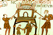 Bayeux Tapestry 1067:  A pictorial narrative account of the conquest of England by William of Normandy and death of Harold II at Battle of Hastings in 1066. Woman and child fleeing from burning house. Textile Linen