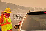 "03 JUNE 2011 - SPRINGERVILLE, AZ: Mike Taylor (CQ) from ADoT, staffs a roadblock on Highway 180 at Nelson Reservoir. The road into Nutrioso and Alpine is closed from here to south of Hannigan's Meadow.  High winds and temperatures have continued to complicate firefighters' efforts to get the Wallow fire under control. The  mandatory evacuation order for Alpine was extended to Nutrioso, about 10 miles north of Alpine and early Friday morning fire was reported on the south side of Nutrioso. The fire grew to more than 106,000 acres early Friday with zero containment. A ""Type I"" incident command team has been called in to manage the fire.   PHOTO BY JACK KURTZ"