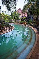 """Nattha Waree Hot Springs is a uniquely landscaped array of hot spring pools, dotted around an immense tropical garden.  The natural mineral water bubbles out between 39° - 49° degrees Celsius .  The minerals include saline salt which has many health benefits, particularly for the skin, as well as soothing muscles and joints.  Nattha Waree was certified by the Thai Ministry of Public Health and classified as q saline spring which is good for heart, blood circulation, and neurological disorders. All in all there are nine different pools, most of which are very hot that is above 40 degrees Celsius.  There is also a mineral water swimming pool that is only warm and last but not least a """"Dr Fish"""" therapy pool, where tiny fish nibble dead skin off of your feet and ankles, and stimulate circulation in the feet."""