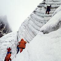 Sherpas practice ice climbing techniques on the Dzongla Glacier at an early mountaineering school for sherpas in the Khumbu region of Nepal, 1980.