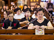 30 MARCH 2018 - BANGKOK, THAILAND: Thai Catholics pray the rosary during Good Friday observances at Santa Cruz Church in the Thonburi section of Bangkok. Santa Cruz Church is more than 350 years old and is one of the oldest Catholic churches in Thailand. Good Friday is the day that most Christians observe as the crucifixion of Jesus Christ. Thailand has a small Catholic community.        PHOTO BY JACK KURTZ